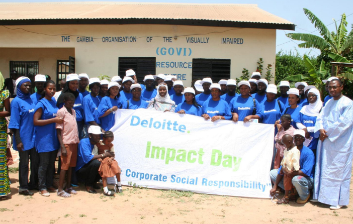 DT-staff-with-the-GOVI-children-(Impact-Day-celebrations)